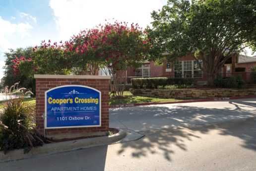 Cooper's Crossing Apartment Homes sign, 1101 Oxbow Dr, drive entrance